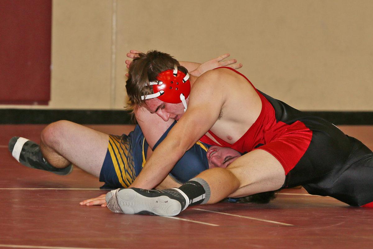 Tyler Sheffield pinning his semi-final opponent.