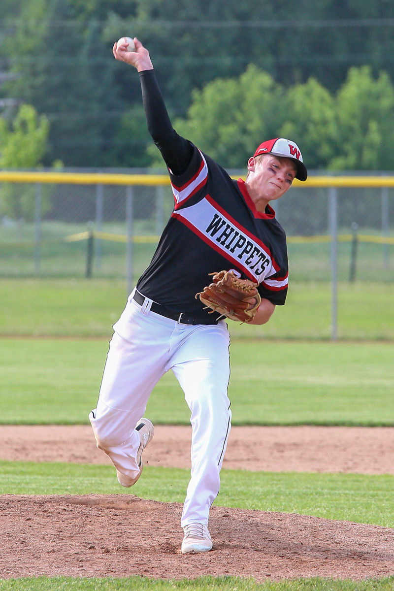 Bryce Parrish throws a pitch in the WIAA regional game.
