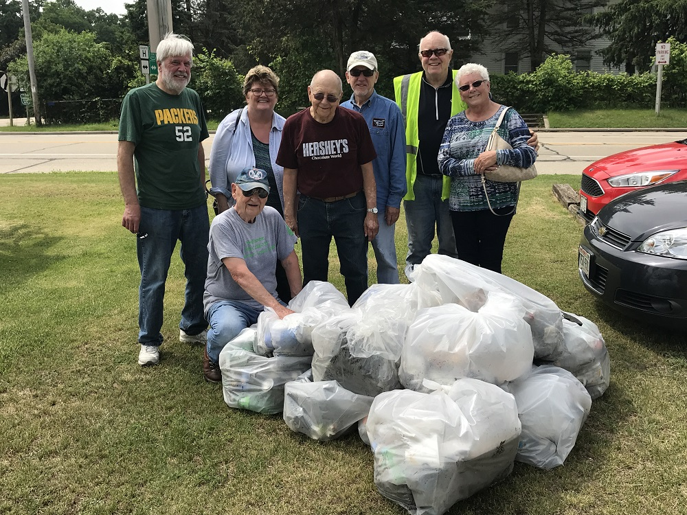 (Left to right) Whitewater Kiwanis Breakfast Club members Lynn Binnie, Marjorie Stoneman, Jerry Grant, Steve Ryan, Rick Norman, Jeanne Obmascher, and Ed Schweitzer (in front), picked up garbage as part of the Adopt-A-Highway program.