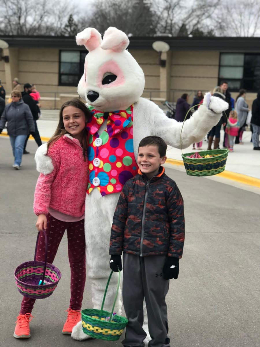 The Easter bunny models with two siblings after the hunt.