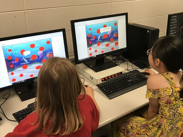 Summer school scholars learning how to code