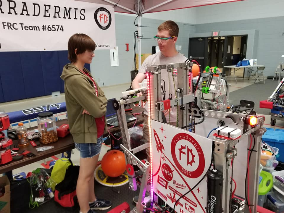 New members had a chance to get some training. Morgan is learning about programming the robot from Zach.