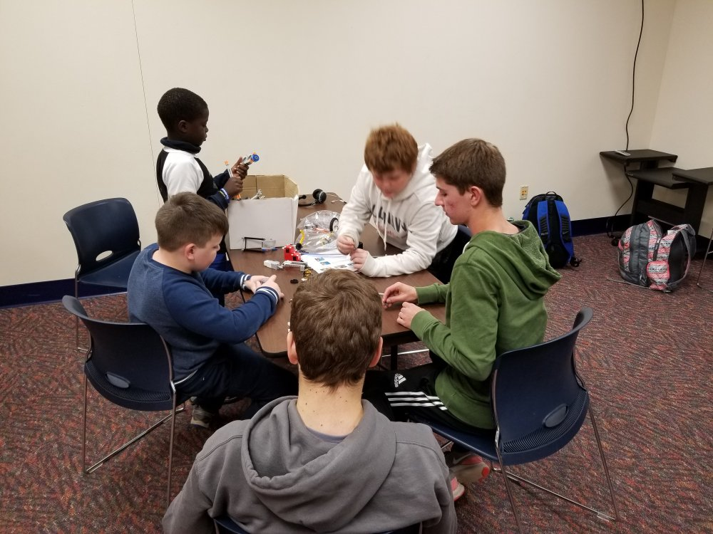 Colin Works with Students Building The Attachments for their Robot