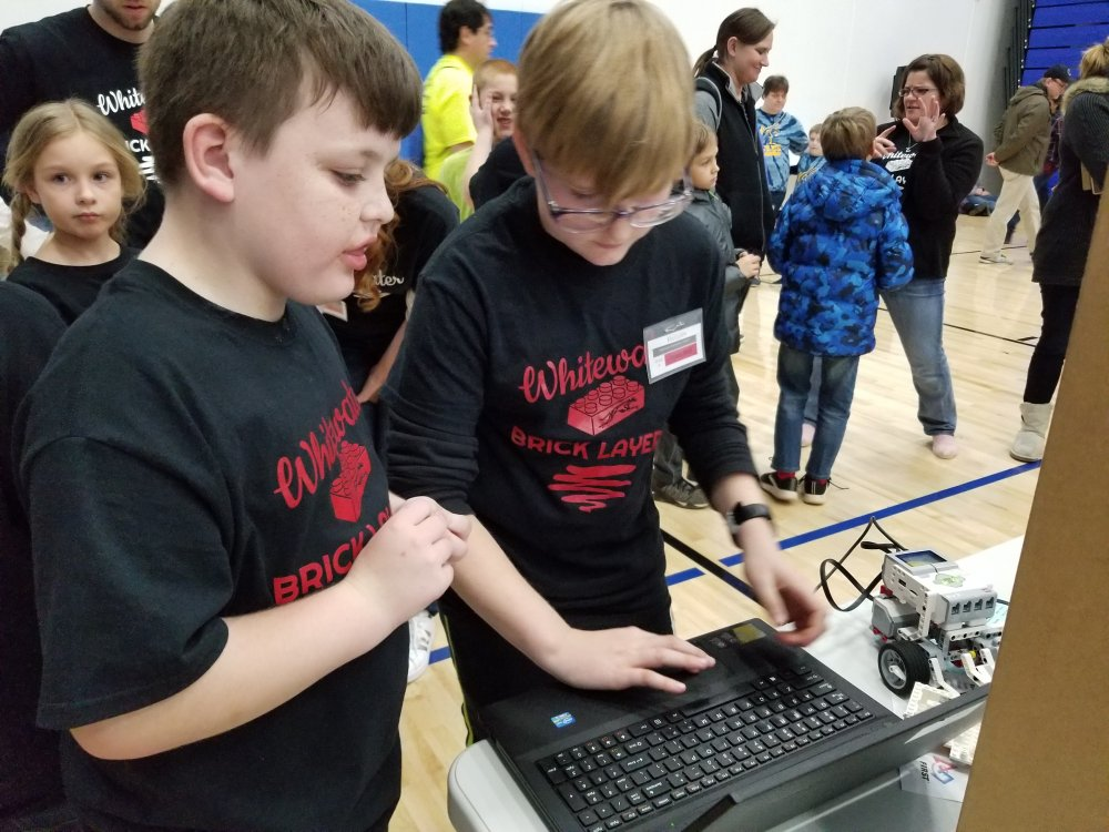 Red Team Members Make Adjustments to their Programming Code