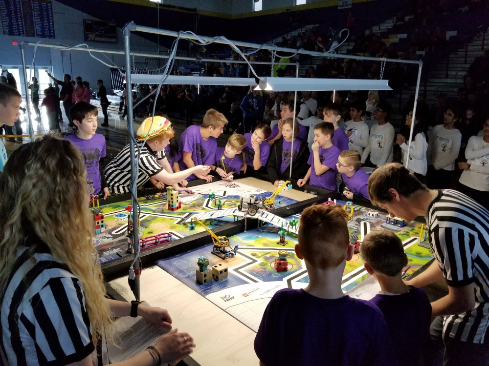 The Middle School Team Discusses Their First Robot Run with the Referees