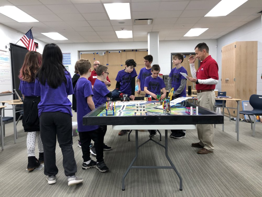 The Middle School Team Meets with the Judges for the Robot and Programming Evaluation (2)