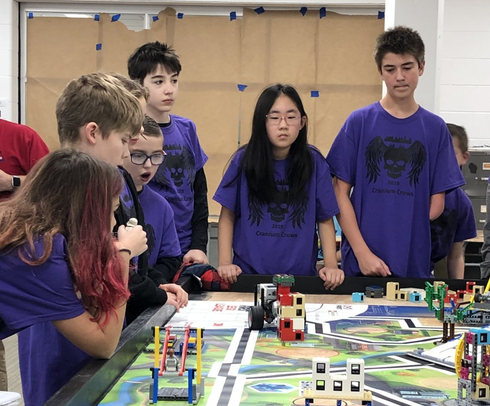 The Middle School Team Meets with the Judges for the Robot and Programming Evaluation