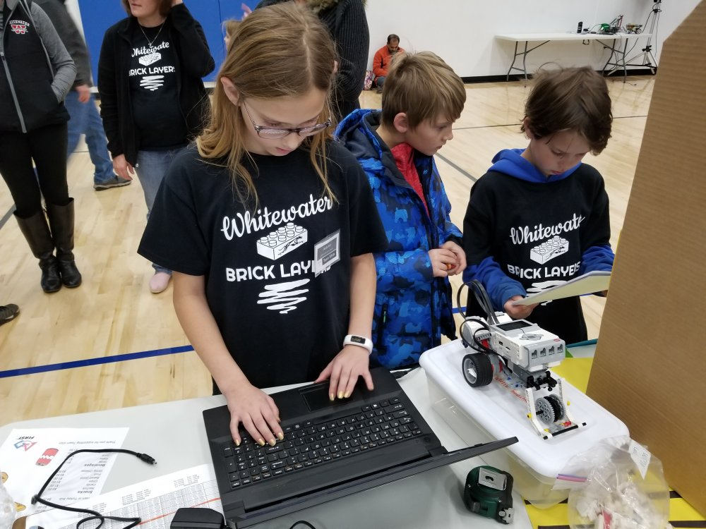 The White Team Makes Adjustments to their Robot Code Between Matches